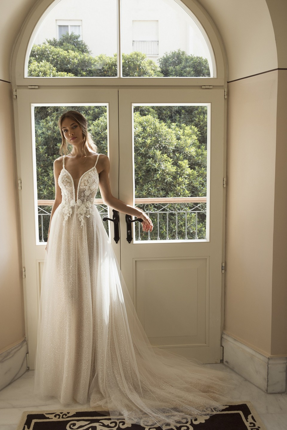 Our favorite tulle with low plunge neck line wedding dress